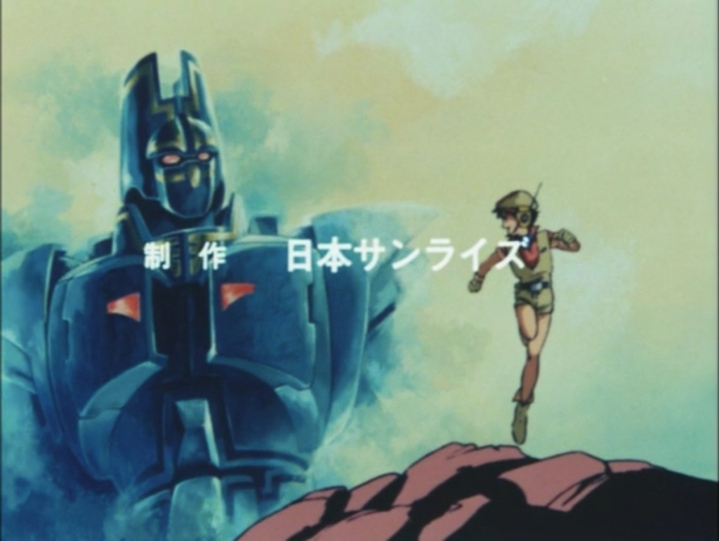 Tagami Yuu, a young boy in an explorer outfit and a beret, looks back at Giant Gorg, a large blue robot, in the background