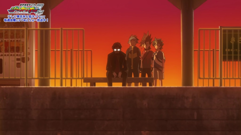 Gendo sitting on a train platform bench next to some Shinkalion Z characters. The background is red and eerie, and Gendo's signature glasses are reflecting light.